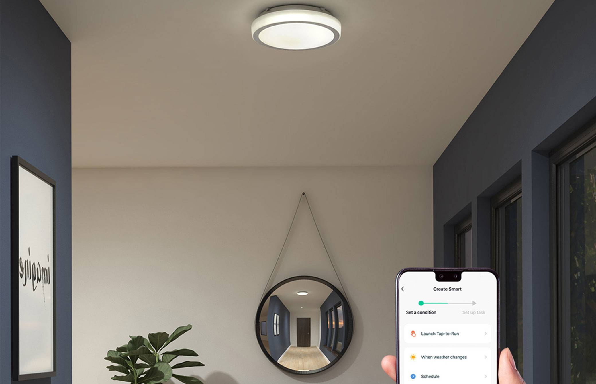Pluto Artika Ceiling Light, being operated by a smartphone