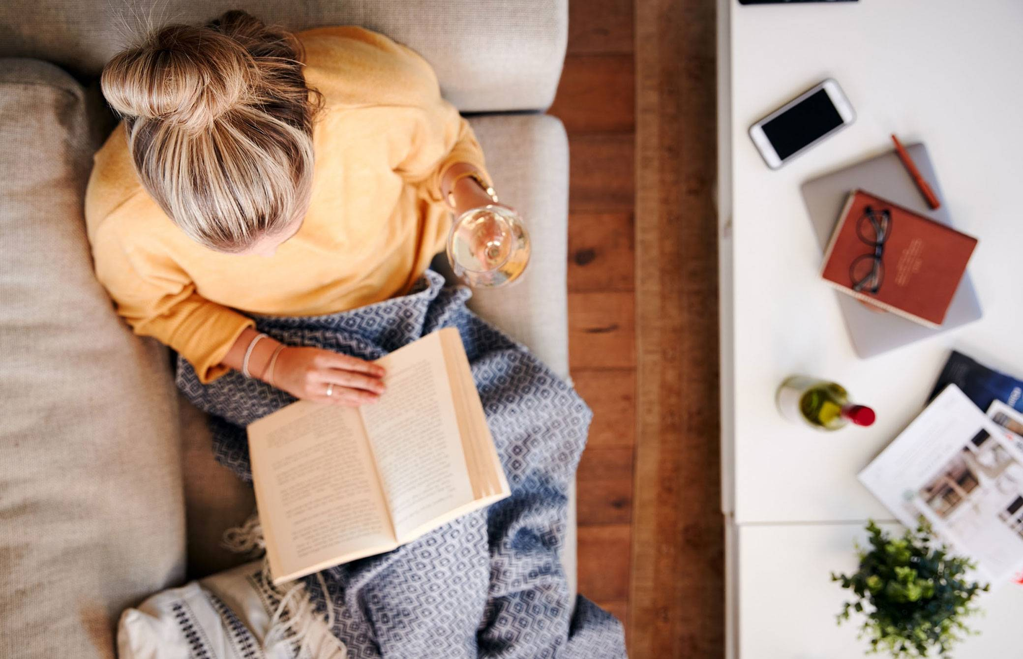 Overhead shot of woman reading on the couch